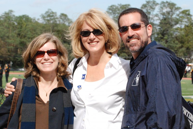huntington-school-board-members-from-left-jennifer-hebert-and-kim-brown-with-superintendent-jim-polansky-at-the-blue-devil-bands-home-show