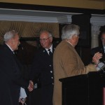 State Fire Officials giving Awards to Frank and Douglas