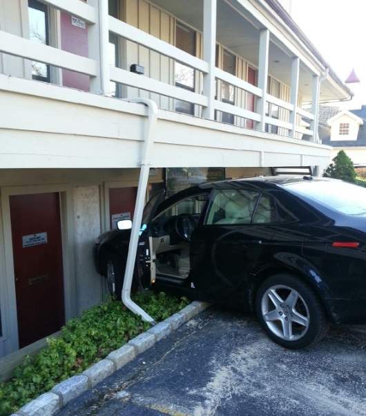 Car Crashes Into Centerport Office Building