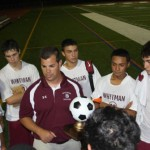 """Coach John DiGiacomo with the tournament trophy tells his team; """"This was a complete team effort tonight."""""""