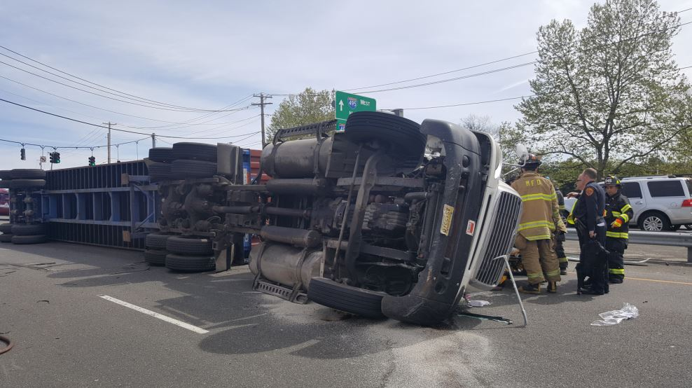 Melville FD Rescues Driver from Overturned Truck on Route